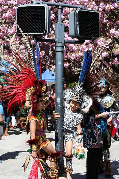 Members of the Huitzilin Cultural Group dressed in beautiful and colorful costumes to celebrate the Aztec culture.
