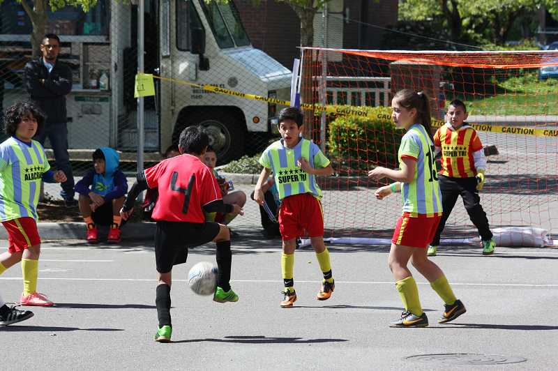 Dozens of kids participated in the all-day Futsal tournament, held in parking lots surrounding the Civic Center. Street soccer has been a highly popular activity during the annual festival.