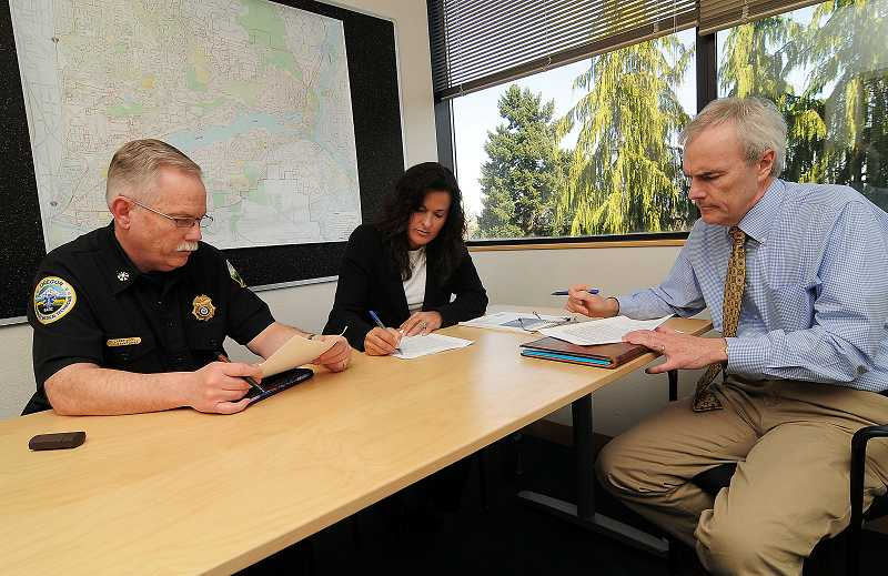 by: REVIEW PHOTO: VERN UYETAKE - Helping Lake Oswego stay one step ahead of disaster is the executive emergency management team of, from the left, Larry Goff, Bonnie Hirshberger and David Donaldson.