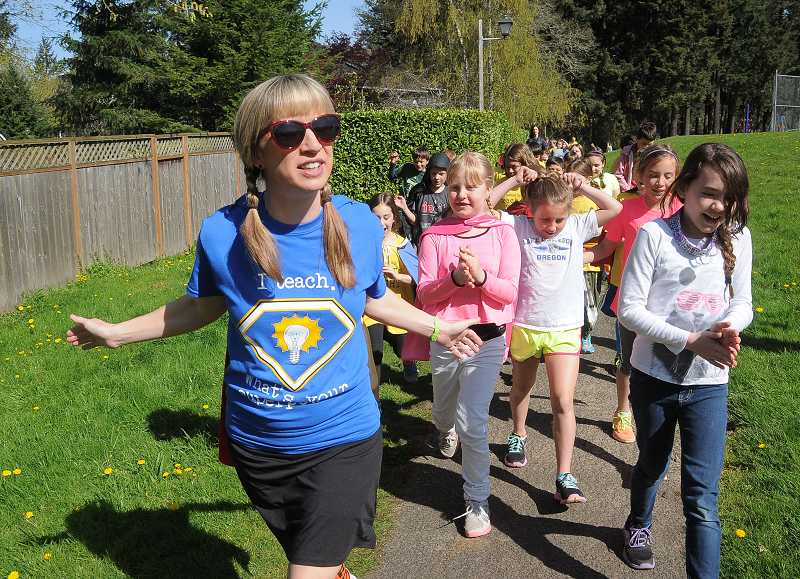 by: REVIEW PHOTO: VERN UYETAKE - Laura Nelson leads her third grade class around the course during the Westridge Walk-a-thon last week.