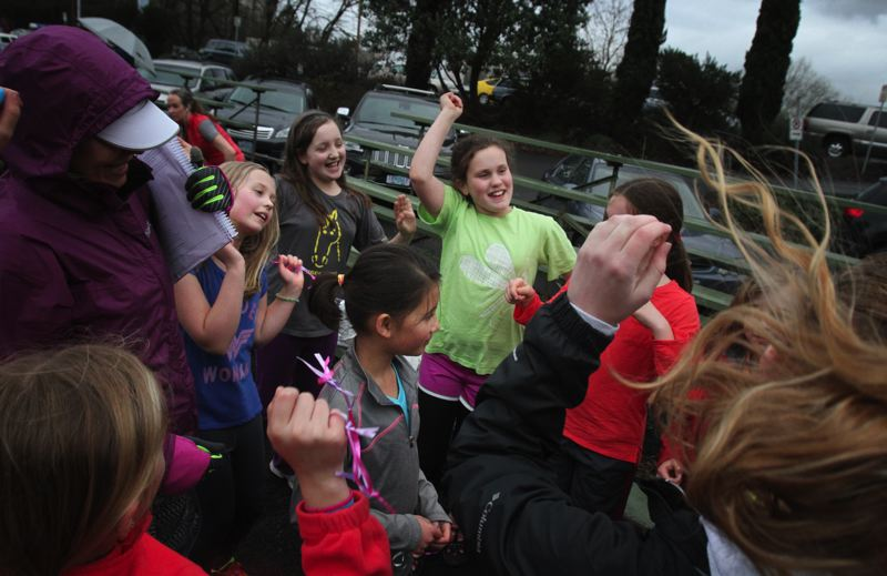 by: TRIBUNE PHOTO: JONATHAN HOUSE - After every practice, the Girls on the Run pick one athlete to celebrate by singing and dancing.