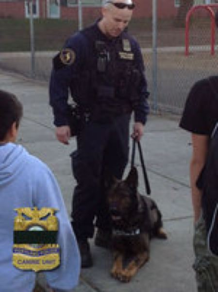 by: PORTLAND POLICE BUREAU - Officer Jeff Dorn and his late K-9 partner, Mick
