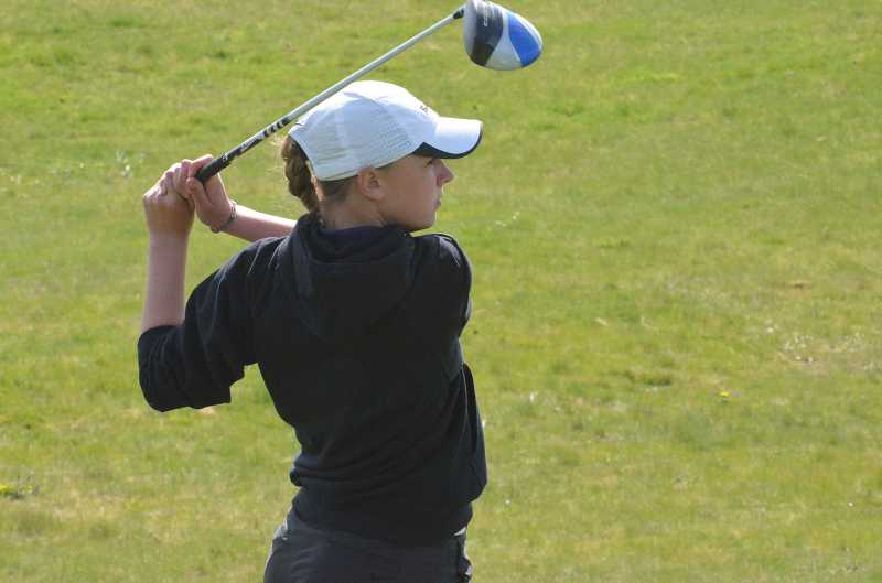 by: JEFF GOODMAN / PAMPLIN MEDIA GROUP - Wilsonville freshman Kaitlyn Howe earned medalist honors April 15 at Chehalem Glenn Golf Course in Newberg with 62 points in the modified Stableford scoring system. Above, Howe tees off April 8 at Stone Creek Golf Course in Oregon City.