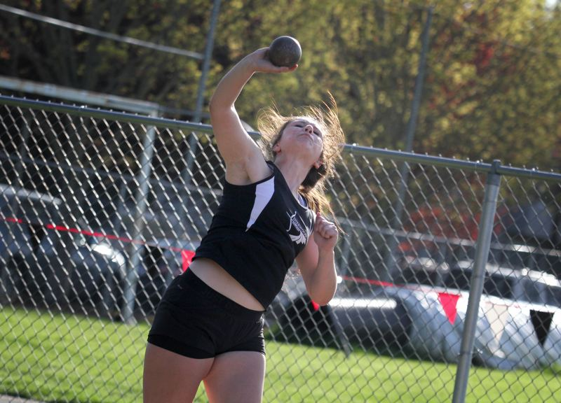by: JONATHAN HOUSE - BIG THROW -- Sherwood senior Elyse Cuthbertson triumphed in all three throwing events, including here in the shot put, in the Bowmen's meet with Milwaukie.