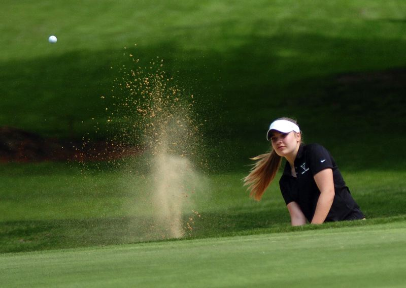 by: DAN BROOD - SAND SHOT -- Tigard's Megan Priaulx blasts the ball out of a bunker on hole No. 14 during Monday's tournament.