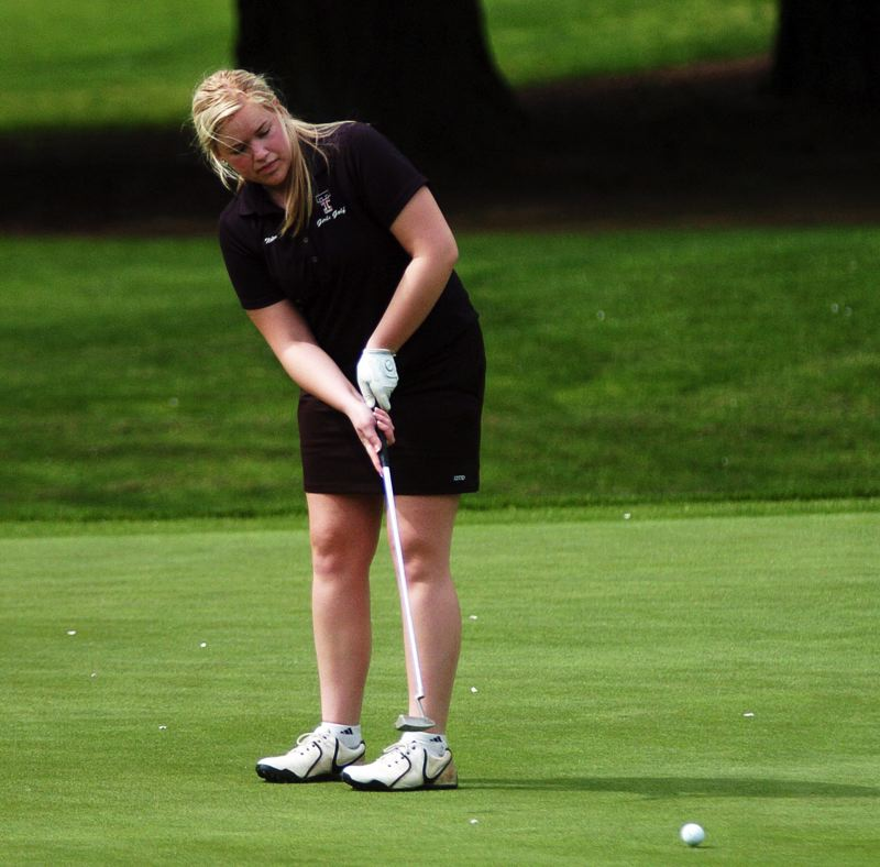 by: DAN BROOD - ON LINE -- Tualatin's Bridget Nolan watches her putt head toward the cup during play at Monday's Pacific Conference tournament.