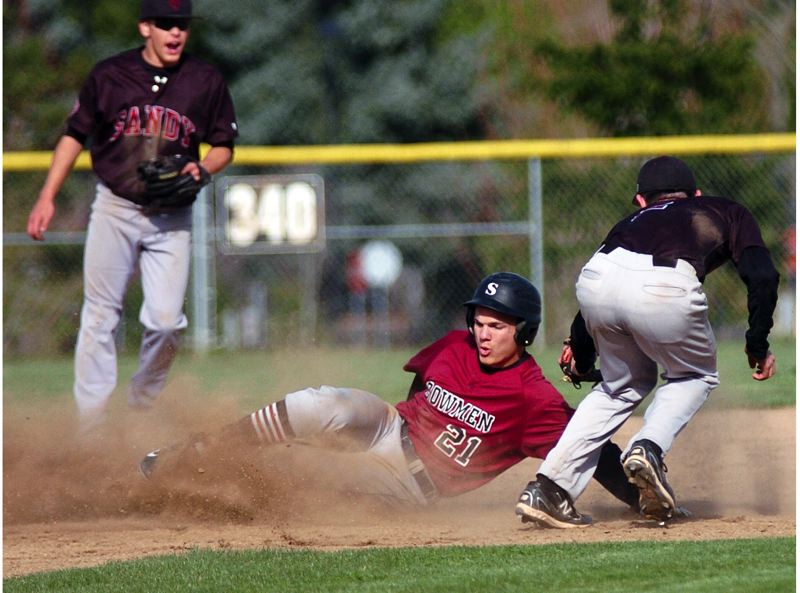 by: DAN BROOD - CLOUD OF DUST -- Sherwood senior Keegan Lawrence (21) steals second base for the Bowmen in their 6-0 win over Sandy.