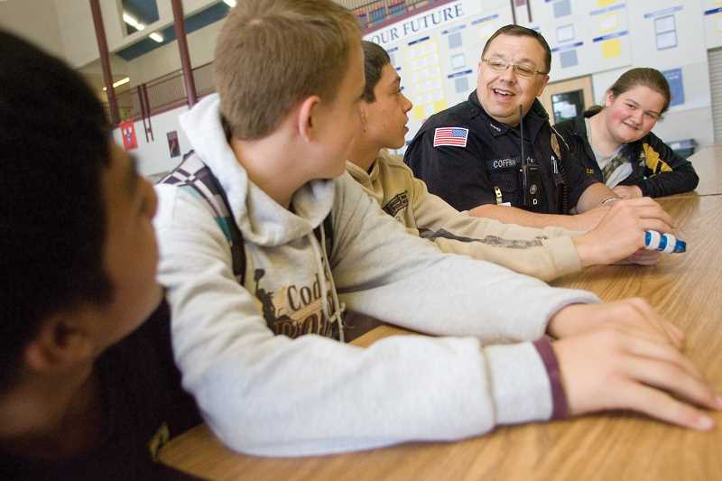 by: KEVIN SPERL - School Resource Officer Jeff Coffman visits with Crook County High School students Pedro Santos (LEFT), Jordan Korpela, Jacob Mickel and Hannah Shadle.