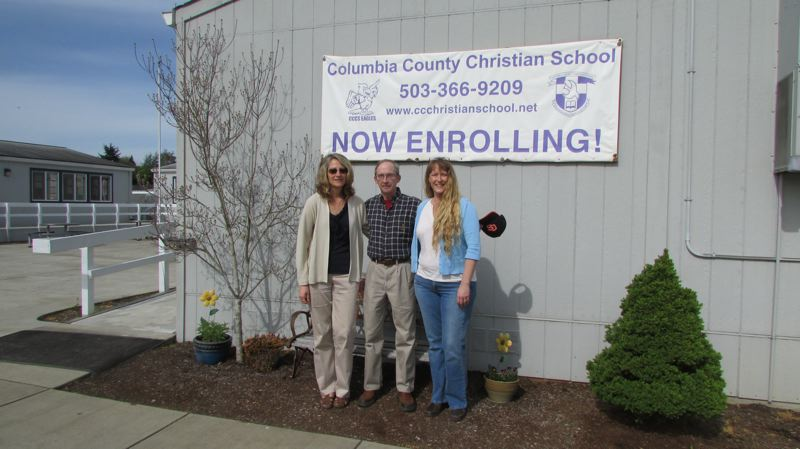 by: DARRYL SWAN - From left: Elementary Principal Rebecca Swatman stands with board members Robert Glosenger and Genet Smiens outside modular units at the Columbia County Christian School campus at 56523 Columbia River Highway. Student enrollment at the private school has nearly quadrupled over the last decade.