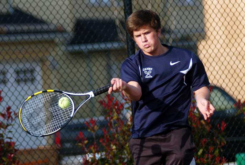 by: DAN BROOD / PAMPLIN MEDIA GROUP - Canby sophomore Austin Evans, shown in a match against Sherwood exchange student Anders Joergensen, is splitting time with junior Ernie Hernandez at No. 1 singles.