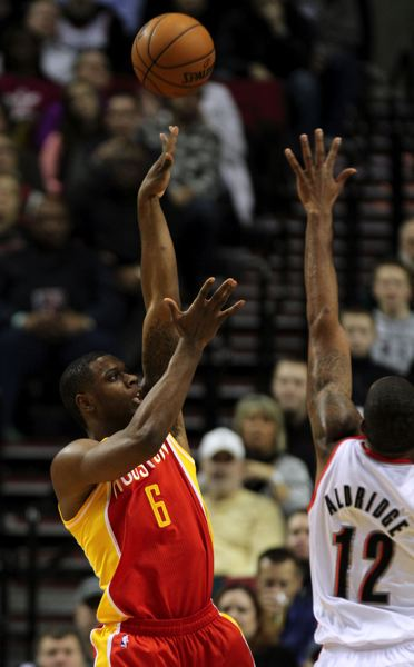 by: TRIBUNE FILE PHOTO: JONATHAN HOUSE - Terrence Jones (left) lofts a jumper over LaMarcus Aldridge during a regular-season game.