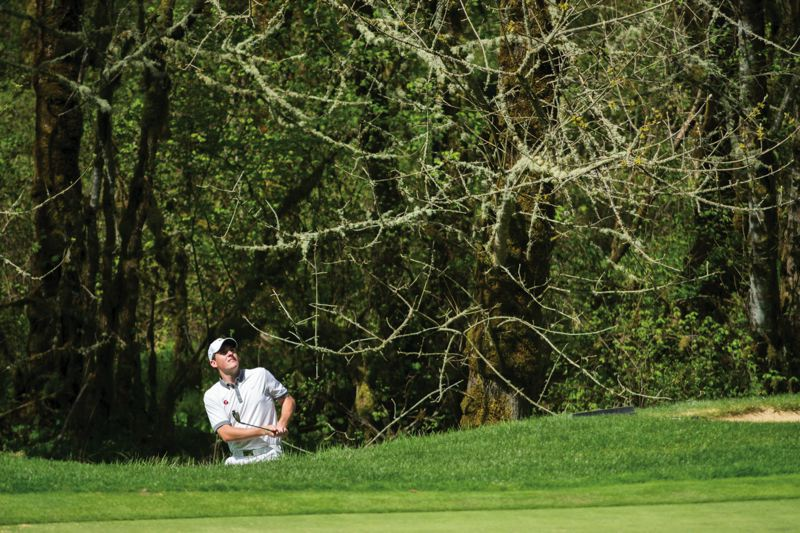 by: HILLSBORO TRIBUNE PHOTO: CHASE ALLGOOD - Glencoes Jared Duvall fires off a shot during Mondays Pacific Conference boys golf tournament at Pumpkin Ridge. Duvall led the Crimson Tide with a fourth-place individual finish.