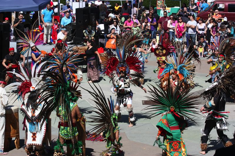 by: HILLSBORO TRIBUNE PHOTO: DOUG BURKHARDT - The Huitzilin Cultural Group, which is based in Dayton, filled the plaza Sunday afternoon with Aztec dancing, music and costumes.