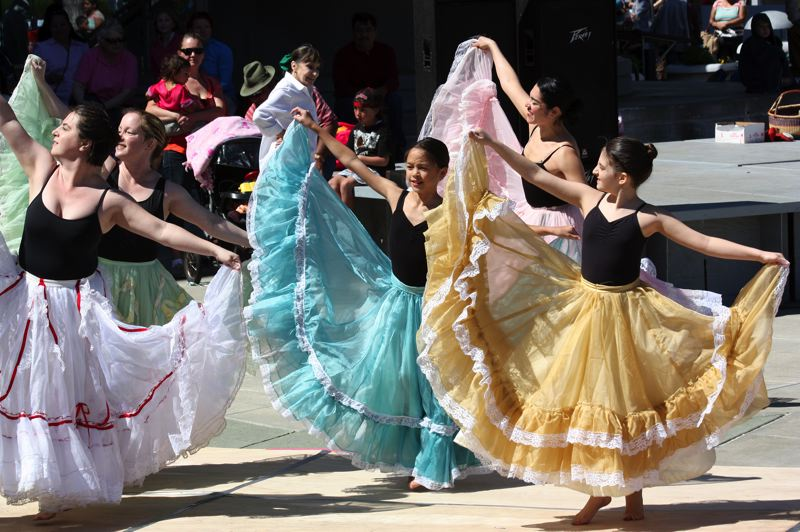 by: HILLSBORO TRIBUNE PHOTO: DOUG BURKHARDT - Dancers in colorful Aztec dress filled the Civic Center plaza with color and music as the annual Latino Cultural Festival got started Sunday.