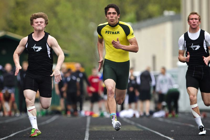 by: JAIME VALDEZ - Putnam senior Tyler Strauss (center) ran a Northwest Oregon Conference best 11.35 for a win in the 100-meter dash in last weeks dual meet with Sherwood.