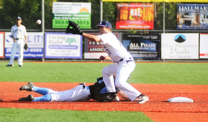 by: MATTHEW SHERMAN - Lake Oswego's Travis Sanders looks to make a play at second base Monday in the Lakers' 4-1 win over Lakeridge. Sanders would come in to pitch in the seventh inning to close out the game.