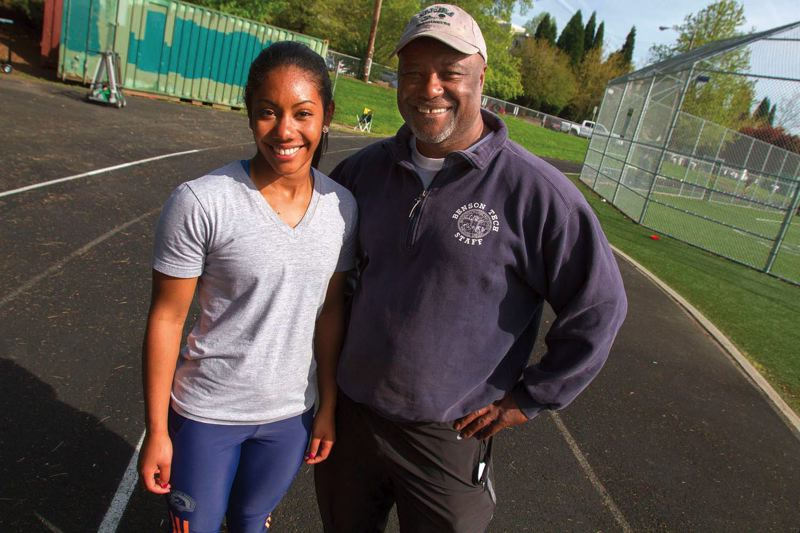 by: TRIBUNE PHOTO: JONATHAN HOUSE - Jasmin McKenzie, a top sprinter and jumper on Benson Highs track and field team, gets some tips from coach/grandfather Leon McKenzie during a workout at the school.