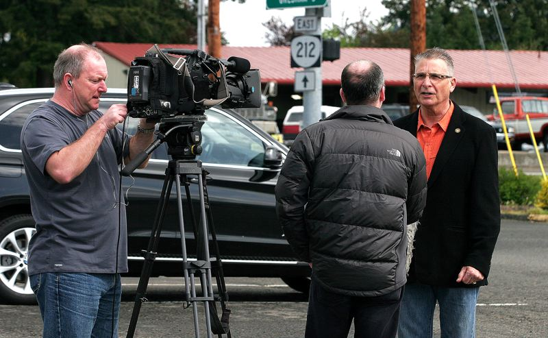 by: OUTLOOK PHOTO: JIM CLARK - BBC reporter Glenn Campbell, back to camera, interviews Rep. Bill Kennemer in Boring with cameraman Andy Halley.