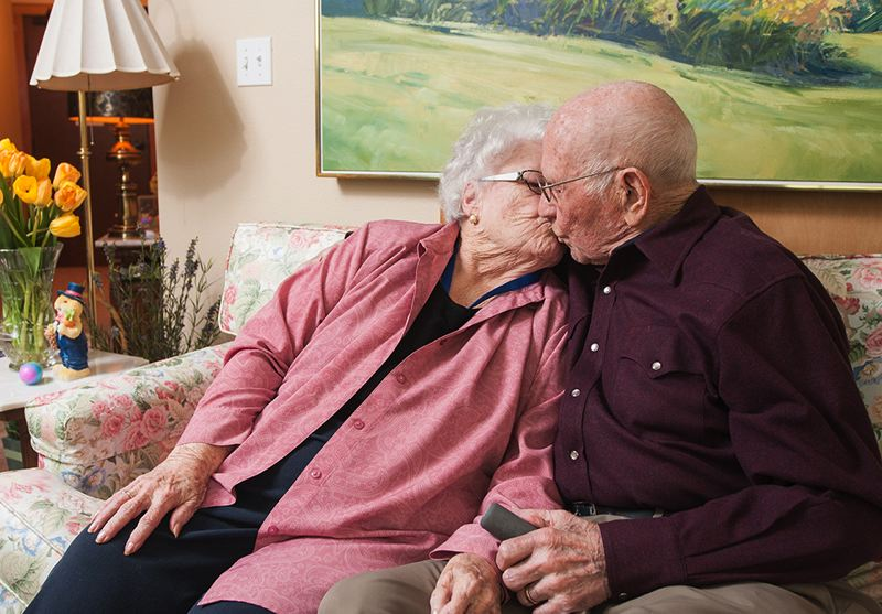 by: SPOKESMAN PHOTO: JOSH KULLA - Lyman and Louise Seely exchange a kiss in their apartment where they live at The Springs in Wilsonville. Longtime residents of Woodburn and now Wilsonville, the couple will celebrate their 75th anniversary on May 9.