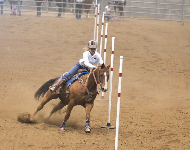 by: LINDA LARSON/FOR THE PIONEER - Jessie Furguson placed fourth in pole bending Saturday and is headed to state next month.