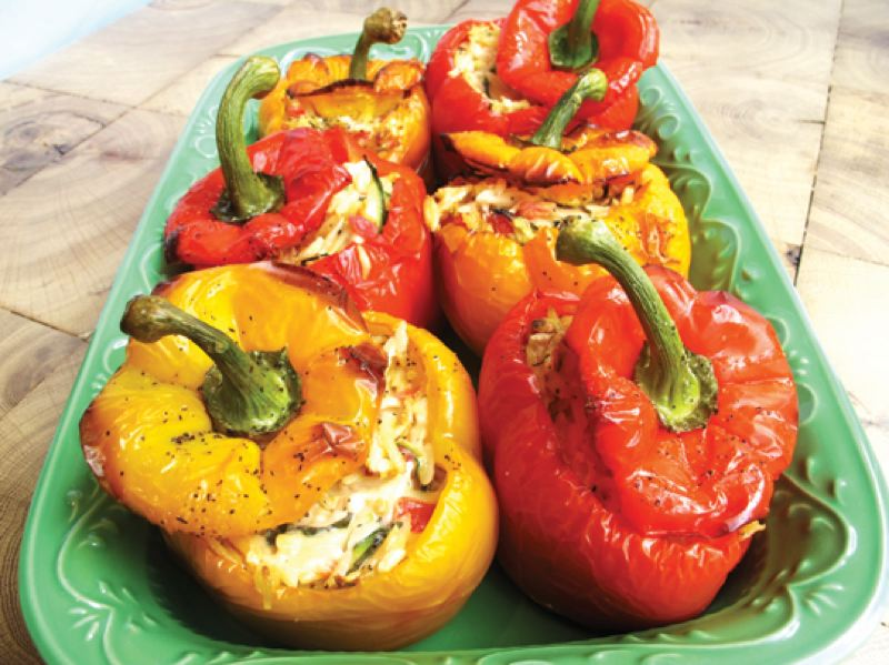 by: NATIVE FOODS PRESS, 2014 - Stuffed bell peppers made by Native Foods Cafe are in the new 'Native Foods Celebration Cookbook.'
