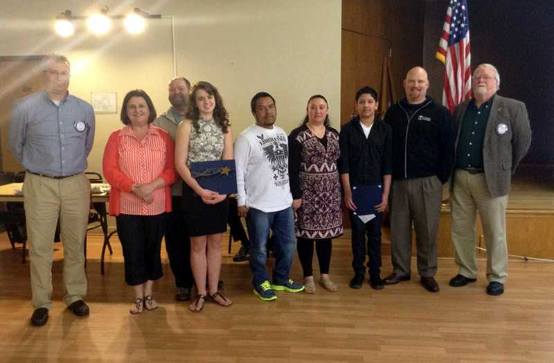 by: COURTESY PHOTOS - The Rotary Club of Forest Grove selected Forest Grove High senior Haley New (fourth from left) and Neil Armstrong Middle School eighth-grader Deangel Hernandez (third from right) as Aprils Youth Citizens of the Month.