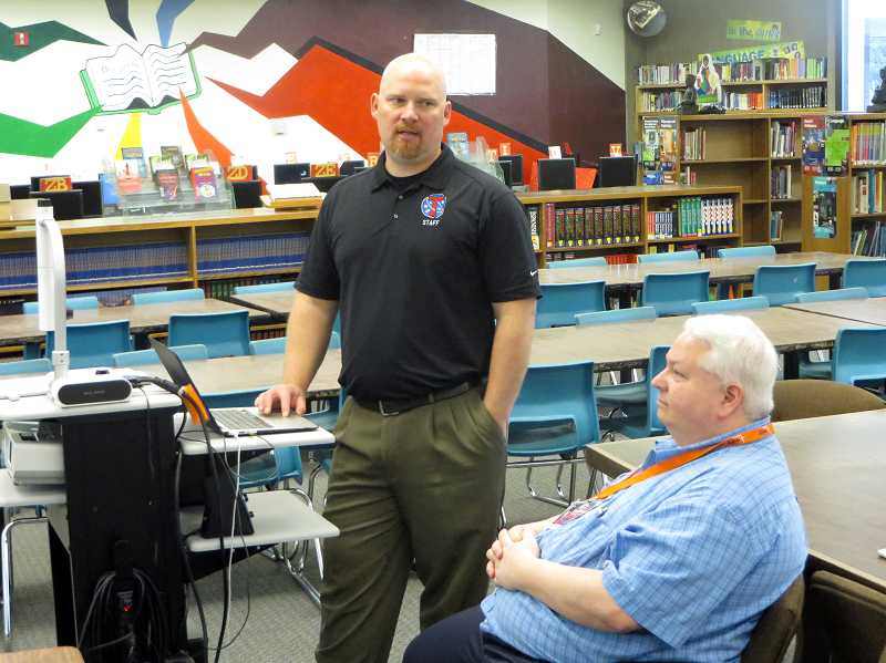 by: COURTESY PHOTO: ART HEERWAGEN - Neil Armstrong Middle School Principal Brandon Hundley and Hillsboro School Board member Glenn Miller observe students working with their iPads.