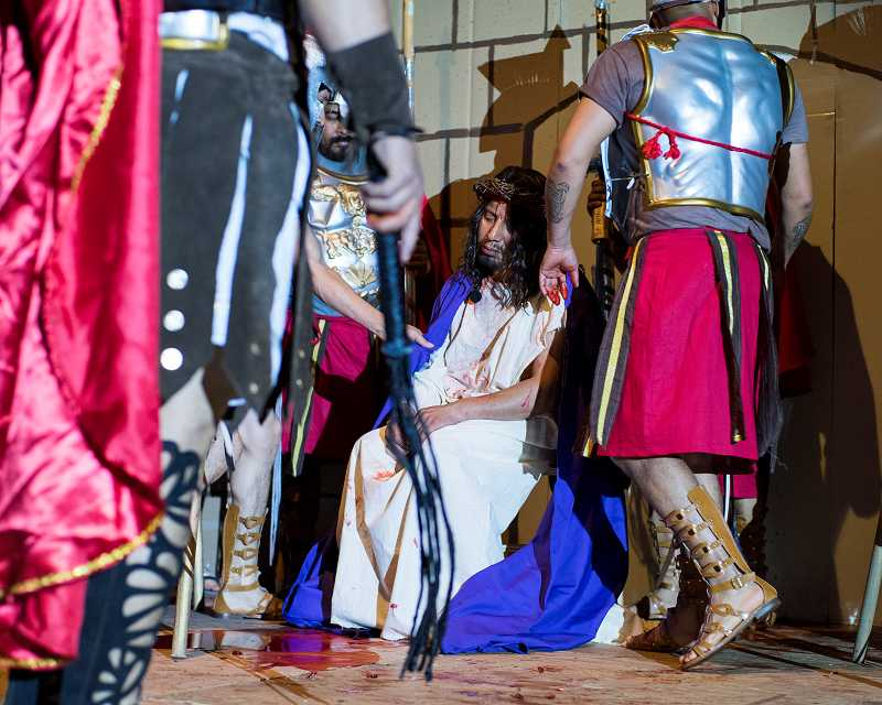 by: NEWS-TIMES PHOTO: CHASE ALLGOOD - Filogonio Ramon Estrada, a member of the Hispanic Charismatic Prayer Group, played Jesus in this years Passion Play at St. Anthonys Catholilc Church in Forest Grove. Here he awaits his bloody fate at the hands of Roman soldiers.