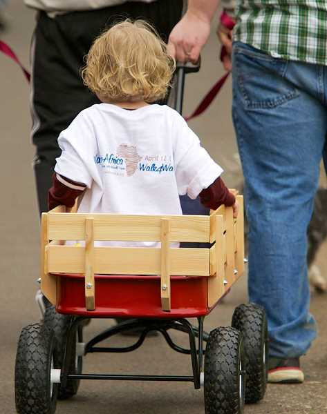 by: SUBMITTED PHOTO: LINDA FAVERO - You did not have to walk to raise money for Walk4Water7. Riding in a red wagon was perfectly acceptable at the event, which drew 300 participants.