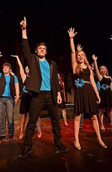 by: REVIEW PHOTO: VERN UYETAKE - Lakeridge High Schools show choir, Company, is a holding a variety show this week featuring students such as Quinn Milionis, left, and Bethany Neuman.