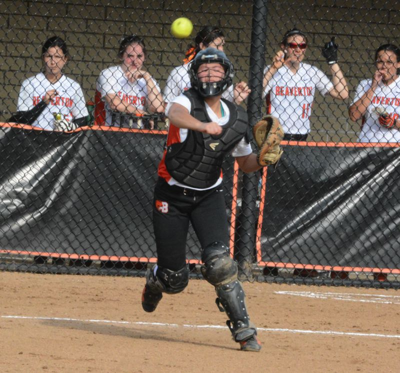 by: TIMES PHOTO: MATT SINGLEDECKER - Beaverton junior catcher Ione Gasser lets a throw go in the third inning of the Beavers tough loss to Westview.