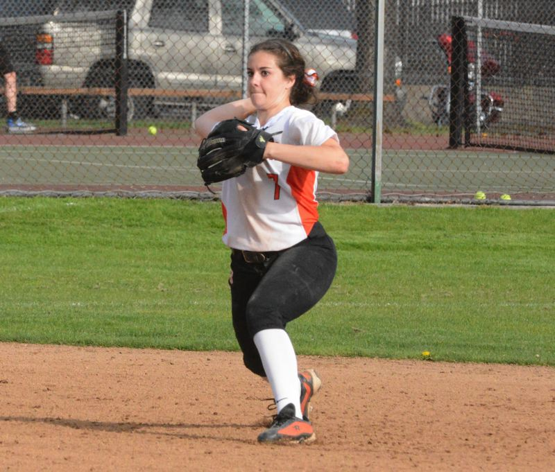 by: TIMES PHOTO: MATT SINGLEDECKER - Beaverton senior shortstop Kaitlin Collins is one of the Beaver upperclassmen guiding a young, but talented team this spring.