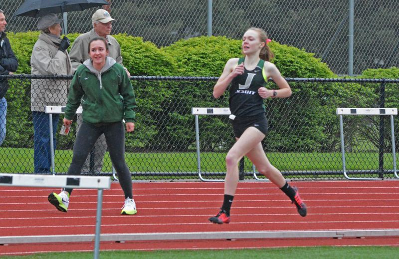 by: TIMES PHOTO: MATT SINGLEDECKER - Jesuit sophomore Zoe Fanning took an early lead in the 800 and never looked back, winning the race over Sunsets Nicole Griffiths on April 16.