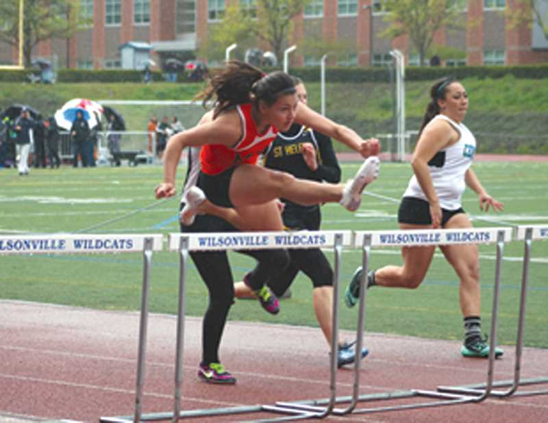 by: JIM BESEDA/MOLALLA PIONEER - Molalla freshman Desiirae DesRosiers ran a personal best of 17.78 seconds in the 100-meter hurdles at Saturday's Wilsonville Invitational track and field meet at Wilsonville High School.