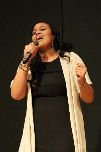 by: TIMES PHOTO: LACEY JACOBY - Jahlett Tofi sings in the Beaverton Teen Idol competition.