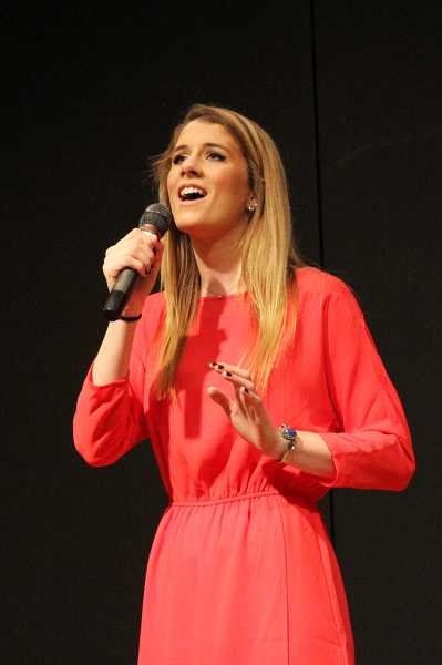 by: TIMES PHOTO: LACEY JACOBY - Dana Hicks sings in the Beaverton Teen Idol competition.