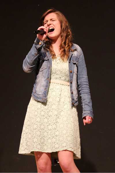 by: TIMES PHOTO: LACEY JACOBY - Brianna Braukmann sings in the Beaverton Teen Idol competition.