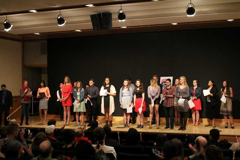 by: TIMES PHOTO: LACEY JACOBY - Contestants in the Beaverton Teen Idol competition stand to be acknowledged.
