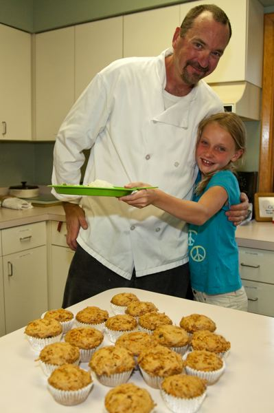 by: COURTESY OF TASTE OF THE NATION - A chef poses with a young Cooking Matters participant, part of Taste of the Nation.
