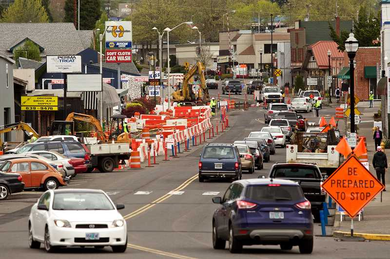 by: TIMES PHOTO: JAIME VALDEZ - Cars navigate along Main Street during heavy construction. Business owners say sales are down significantly because of road work.