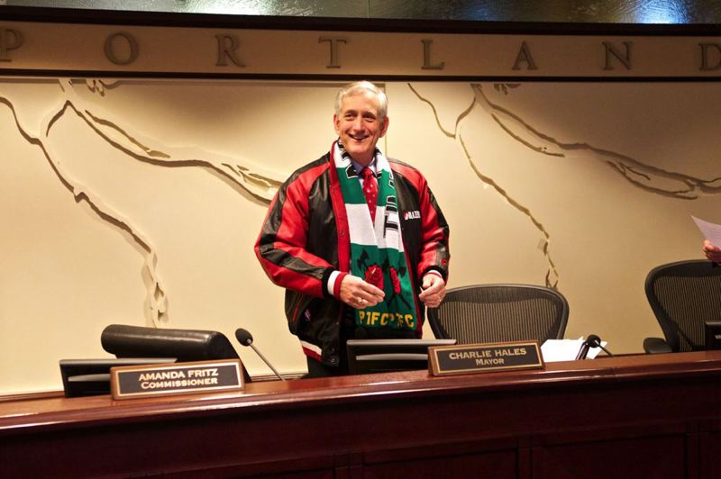 by: TRIBUNE PHOTO: JAIME VALDEZ - Mayor Charlie Hales shows off his support of both the NBA Trail Blazers and the MLS Portland Timbers Wednesday morning at City Hall.