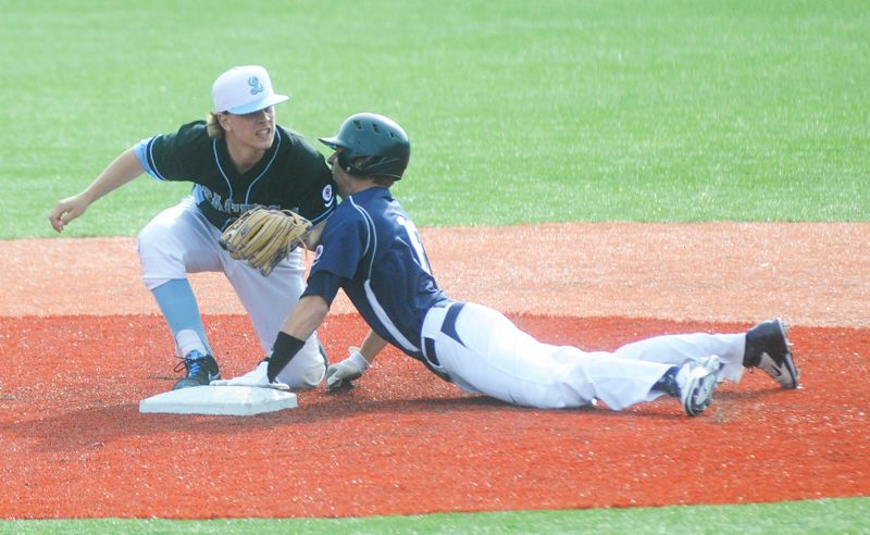 by: MATTHEW SHERMAN - Lake Oswego's Harrison Reece slides into second base just ahead of a throw in the Lakers' victory over Lakeridge Friday. Reece also pitched a shutout for the Lakers in last Wednesay's game.