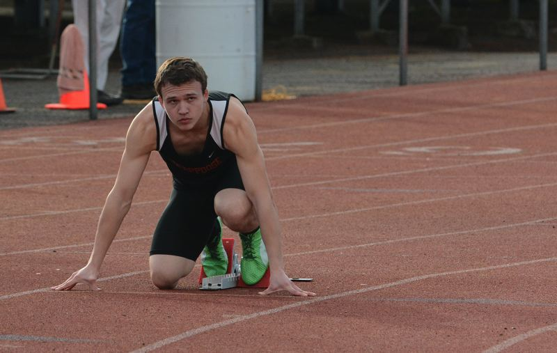 by: JOHN WILLIAM HOWARD - Scappoose senior Mychal Hortert sets up for the 400 meter run during the Indians' icebreaker meet with Cascade and St. Helens on March 20. Hortert runs a leg of the 4x400 meter relay, which is the fastest in the state this year at the 4A level.