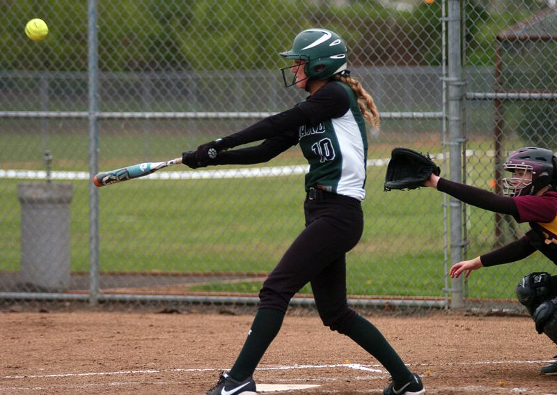 by: DAN BROOD - SMACK -- Tigard junior Alexa Hansen belts a sixth-inning double in the Tigers' game with Forest Grove.
