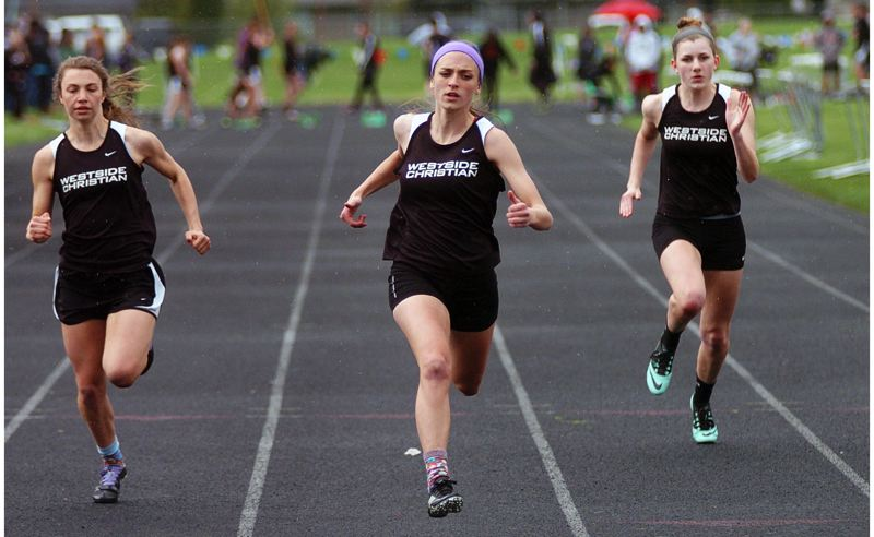 by: DAN BROOD - EAGLE POWER -- Westside Christian's Ryan Conlin (center), with teammates on each side of her, won both the 100 and 200-meter dashes during last week's meet at Dayton.