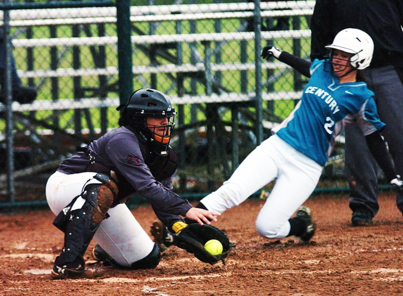 by: DAN BROOD - PLAY AT THE PLATE -- Tualatin junior catcher Jasmine Miller (left) catches the ball as a Century player slides toward the plate in Monday's Pacific Conference game. Miller belted a pair of doubles for the Wolves in their 5-1 victory.