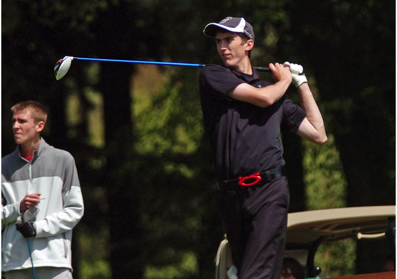 by: DAN BROOD - THE DRIVE -- Tualatin's Johnathan Whittle watches his drive on hole No. 12.