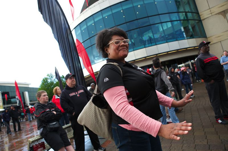 Trina Walker of Portland dances to music during the fan festivities before the game.