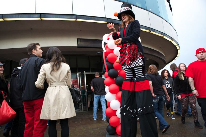 Heather Pearl stands on stilts as she welcomes Blazers fans to Moda Center.