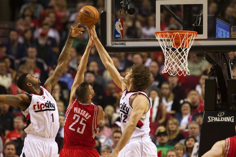 Dorell Wright (left) and Robin Lopez (right) reject Houston forward Chandler Parsons.